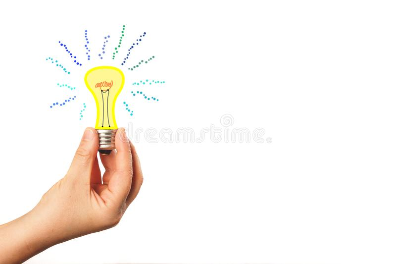Hand holding a burning light bulb at the white background. The concept of new ideas, innovations and business development. stock images