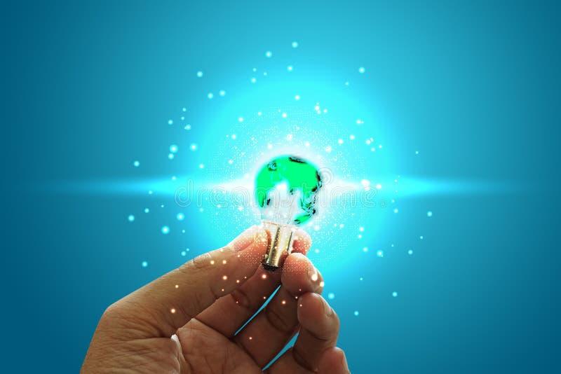 Innovative idea in businessman hand. Innovative idea concept. Green earth ligth bulb on hand royalty free stock photography