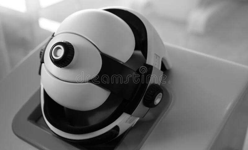 Innovative modern helmet for medical diagnostics black-white photo. stock photo