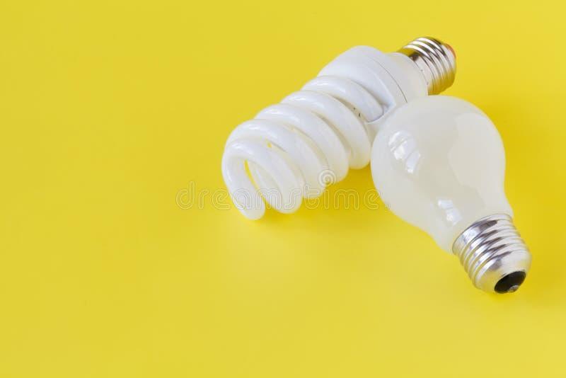 Innovative and plain old light bulb stock photos