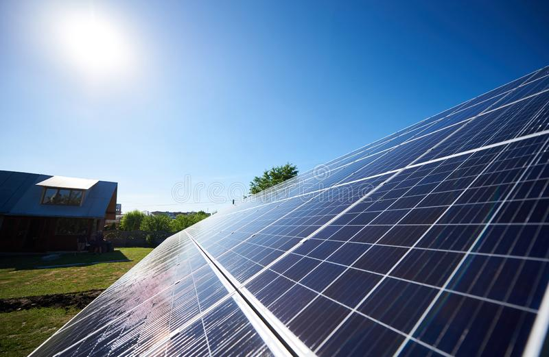 Innovative solar panels mounted on building`s facade. New modern technology using renewable solar energy, saving natural, ecological resources. Environment stock photography