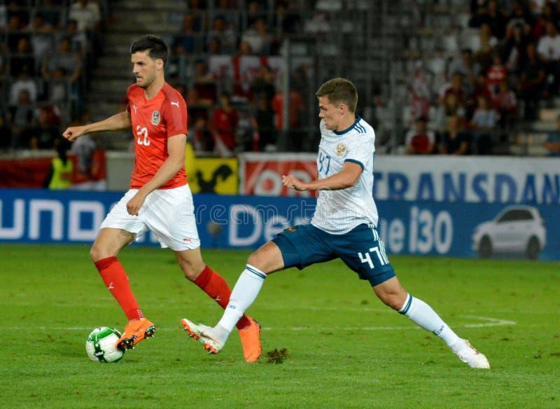 Roman Zobnin against Austrian midfielder Florian Grillitsch. Innsbruck, Austria - May 30, 2018. Russian midfielder Roman Zobnin against Austrian midfielder royalty free stock photography