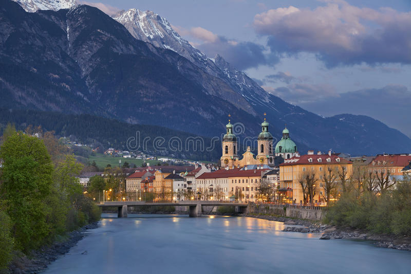 Innsbruck. Image of Innsbruck, Austria during twilight blue hour with European Alps in the background stock images