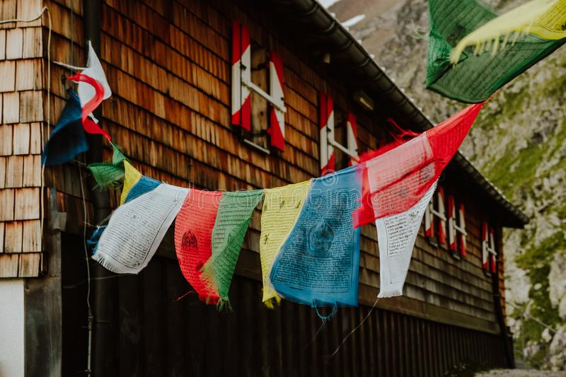 Prayer flags at The Innsbrucker Hutte Mountain Hut stock images