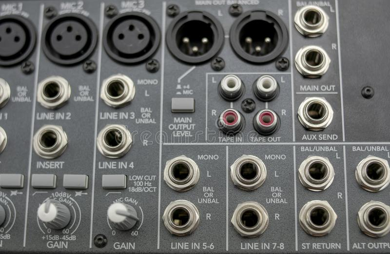 Inputs and outputs of an analog audio mixer with eight channels stock photography