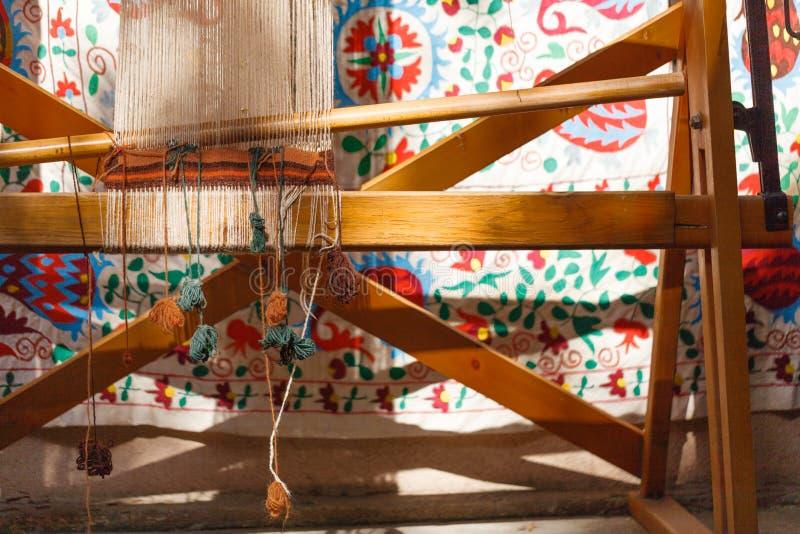 Inrama för framställning av en georgian matta med ull med mattor i royaltyfri fotografi