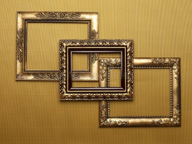 inramniner guldöverlappning arkivfoto