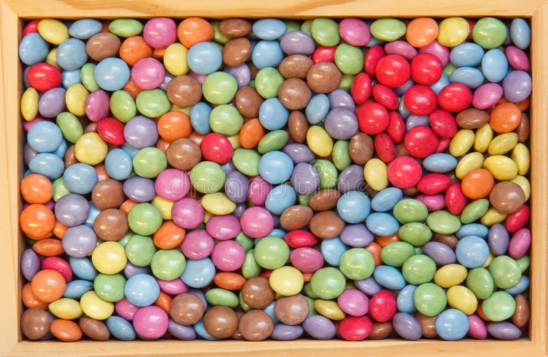 Inramning chokladgodis royaltyfria bilder