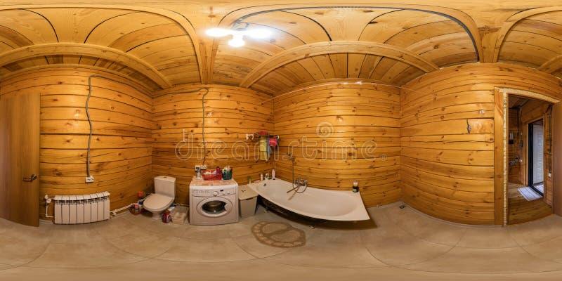 Inre av badrummet i ett trähus av strålar, sfärisk panorama 360Vr arkivfoton