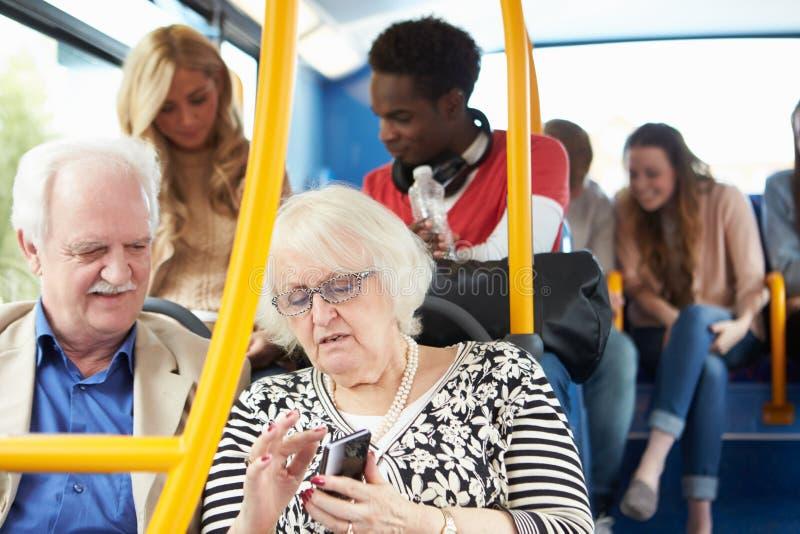 Inre av bussen med passagerare royaltyfria foton