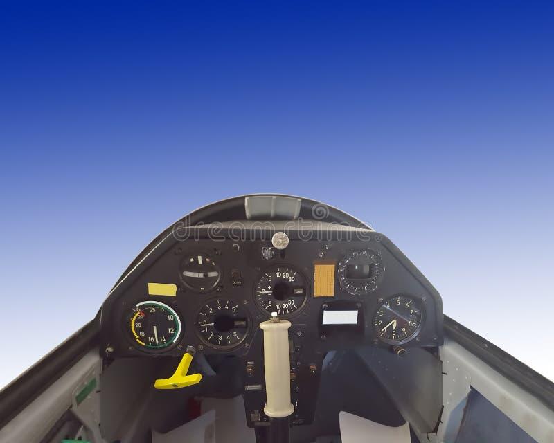 Inre av glidflygplanflygplan på blå himmel fotografering för bildbyråer