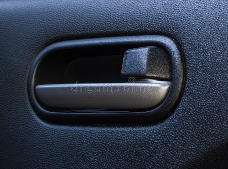 Inre bil för dörrhandtag royaltyfri bild