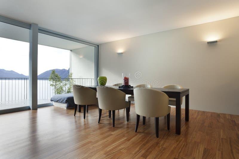 inre modern sikt för lägenhet arkivfoto