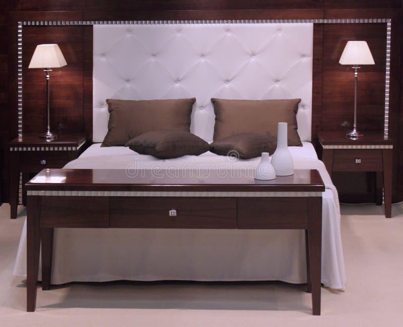 inre modernt för härlig sovrumdesign royaltyfri fotografi