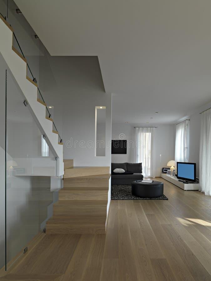 Inre sikt av modern vardagsrum med trappuppgången arkivfoton