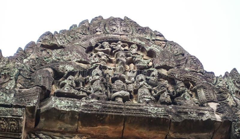 Inristad modellvägg av den Bayon templet på Angkor Thom fotografering för bildbyråer