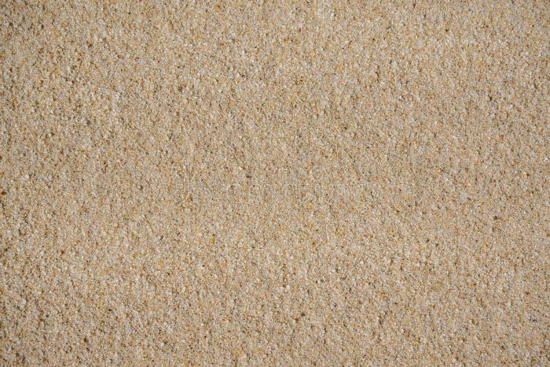 Insabbi la struttura, la sabbia di Brown, fondo dalla sabbia fotografie stock libere da diritti