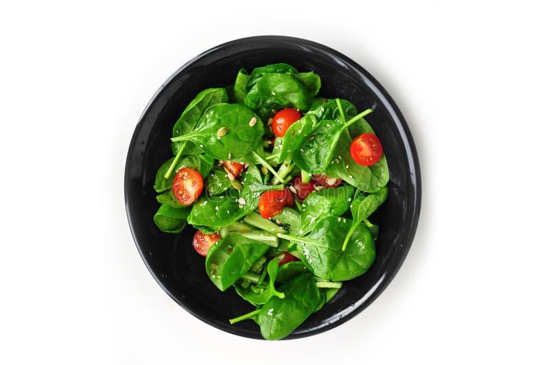 Insalata succosa con spinaci ed i pomodori fotografie stock