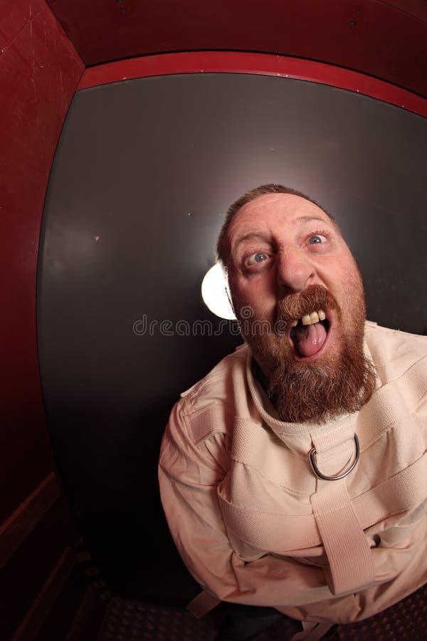 Insane Man In A Straitjacket Royalty Free Stock Photos