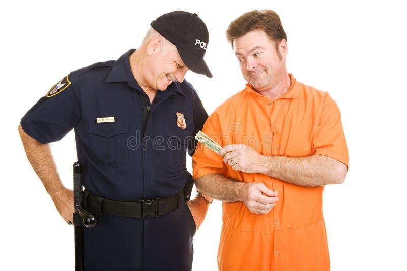 Insasse besticht Polizeibeamten lizenzfreies stockbild