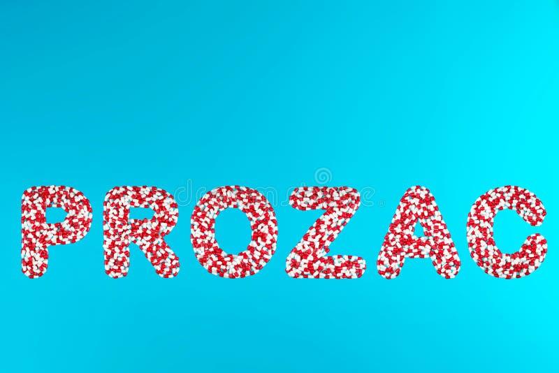Inschrijvings prozac witte en rode pillen stock afbeeldingen