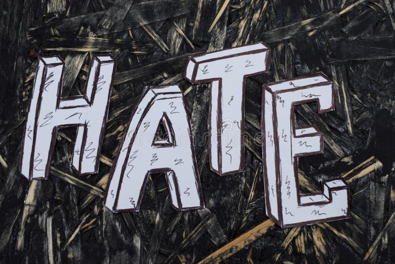 Inscrição, ódio, no fundo do hernom com letras brancas imagens de stock