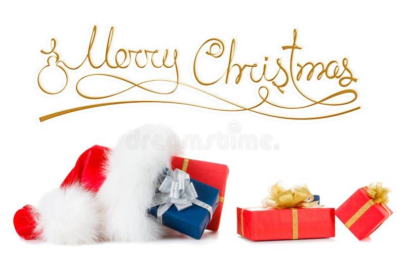 Inscrição do Feliz Natal, chapéu vermelho de Santa com presente imagens de stock royalty free