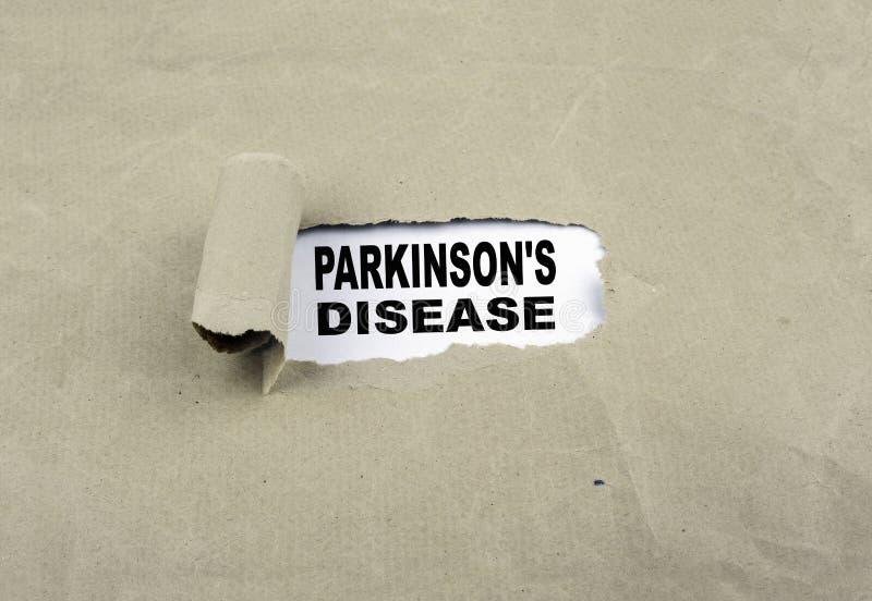 Inscrição revelada no papel velho - Parkinson& x27; doença de s fotografia de stock royalty free