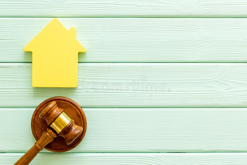 Inscribed gavel, house figure for inheritance concept on mint green wooden background top view copyspace.  stock photos