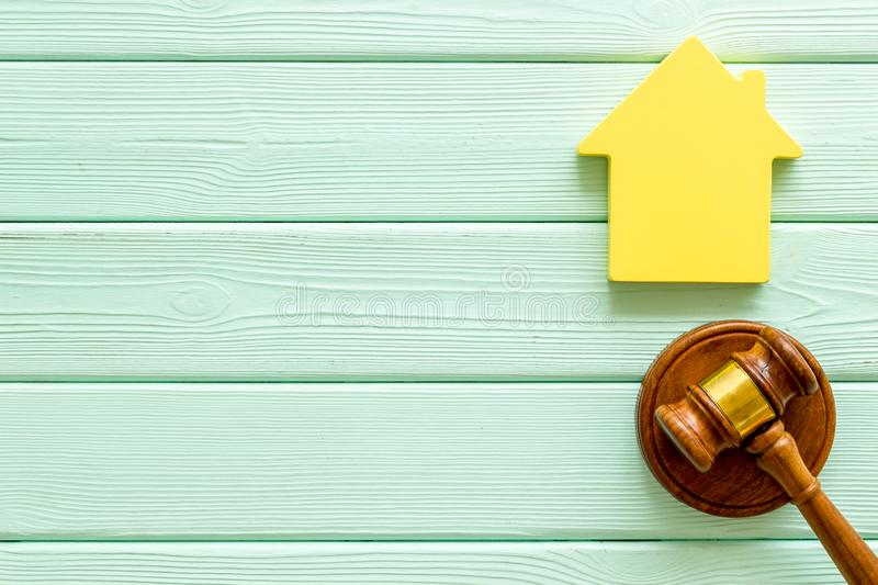 Inscribed gavel, house figure for inheritance concept on mint green wooden background top view copyspace.  stock images