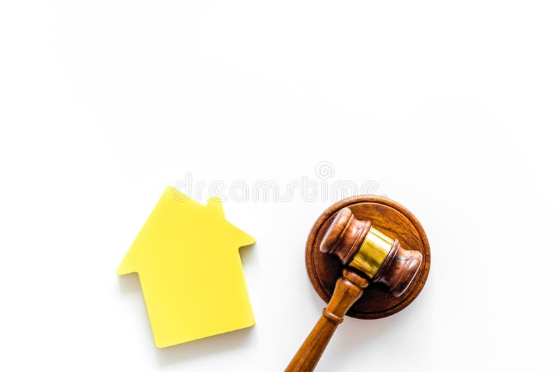 Inscribed gavel, house figure for inheritance concept on white background top view copyspace.  stock images