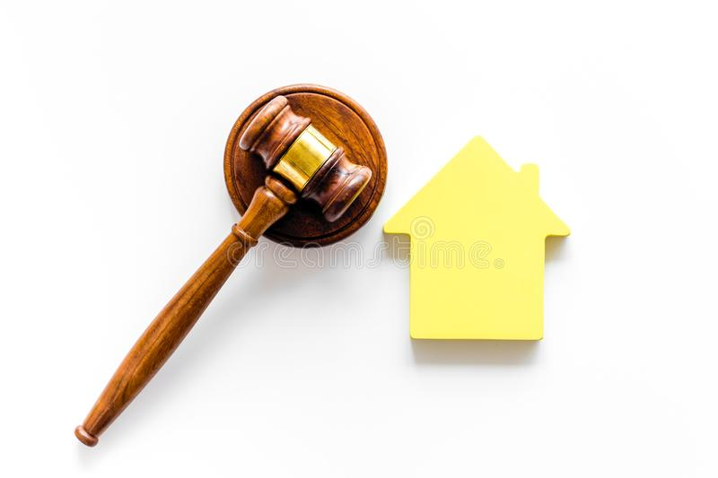 Inscribed gavel, house figure for inheritance concept on white background top view.  royalty free stock photography