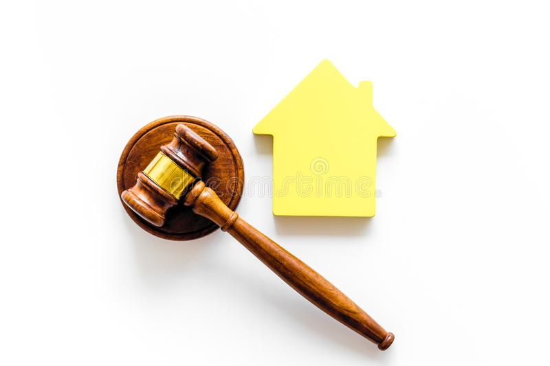 Inscribed gavel, house figure for inheritance concept on white background top view.  royalty free stock images