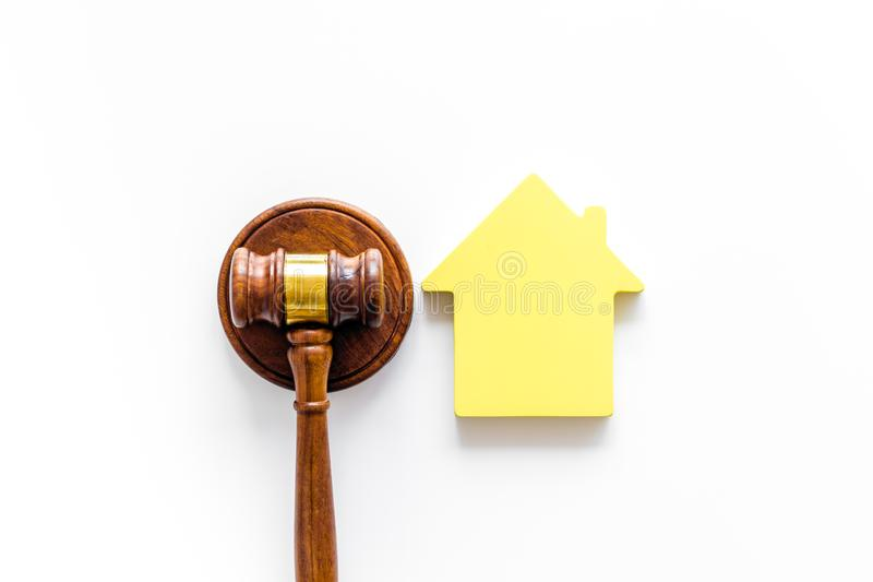 Inscribed gavel, house figure for inheritance concept on white background top view.  stock image