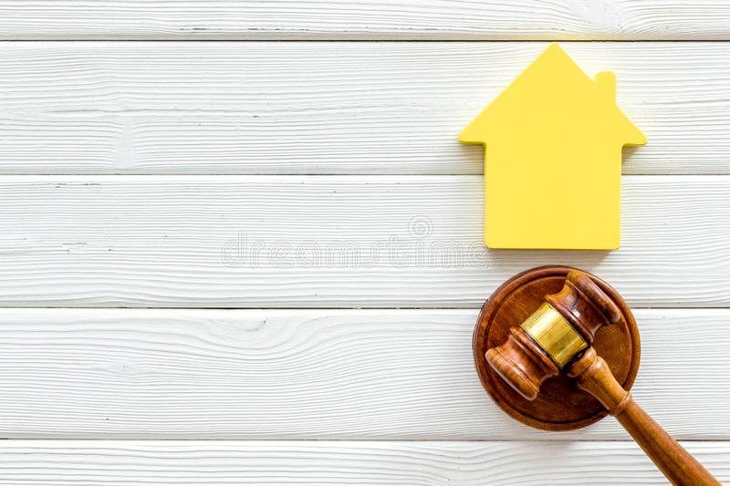 Inscribed gavel, house figure for inheritance concept on white wooden background top view copyspace.  royalty free stock images