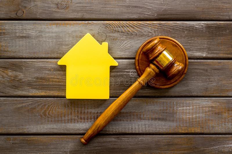 Inscribed gavel, house figure for inheritance concept on wooden background top view.  stock image