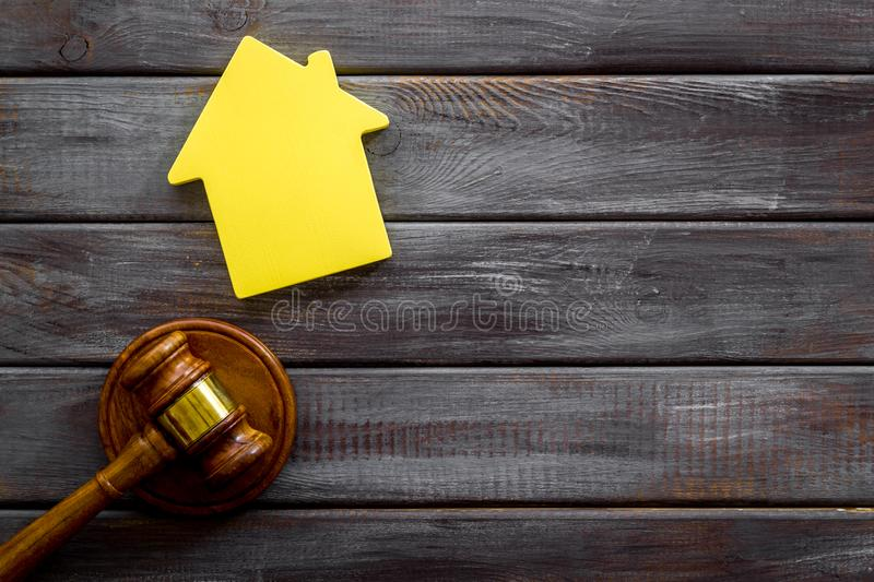 Inscribed gavel, house figure for inheritance concept on wooden background top view copyspace.  stock image