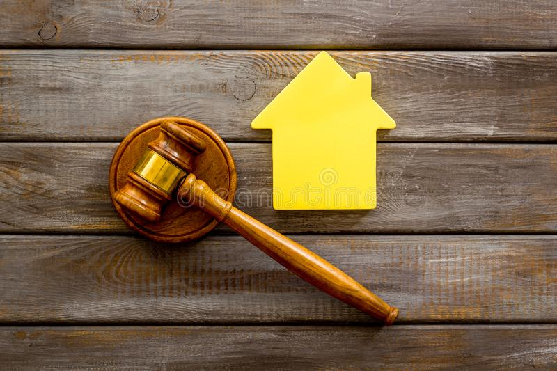 Inscribed gavel, house figure for inheritance concept on wooden background top view.  royalty free stock photography