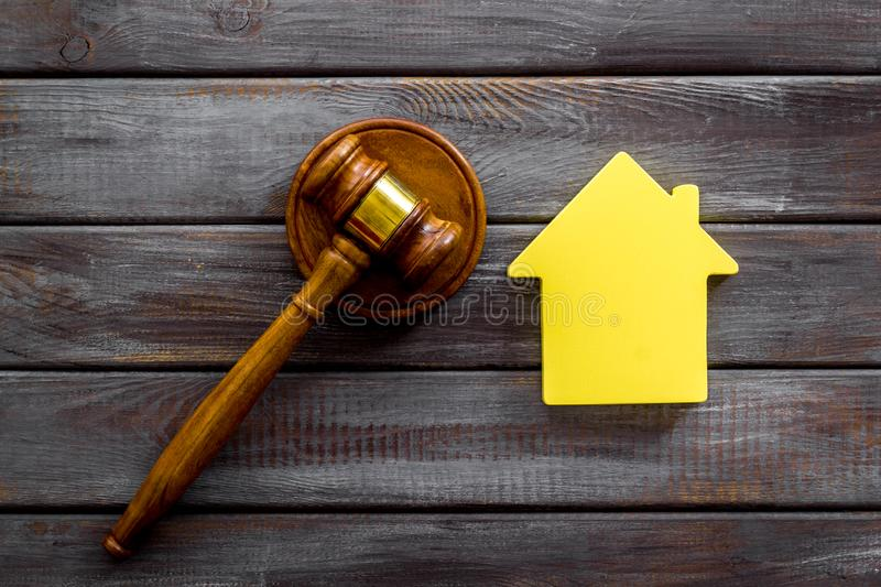 Inscribed gavel, house figure for inheritance concept on wooden background top view.  royalty free stock photos