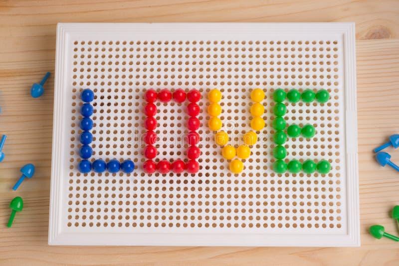 Inscripción del amor con los elementos del mosaico Saludo del día del ` s de la tarjeta del día de San Valentín fotografía de archivo libre de regalías