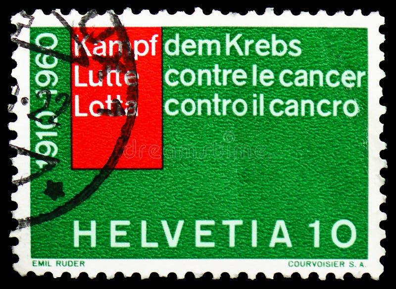 Inscripción en 3 idiomas: 'Lucha contra cáncer ', serie de los sucesos actuales, circa 1960 foto de archivo libre de regalías