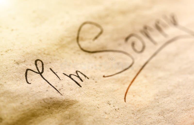 Inscripción negra en trozo de papel foto de archivo libre de regalías