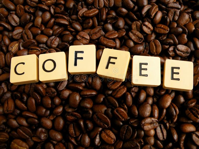 Download Inscript Coffee Written On Cubes On Coffei Beans Royalty Free Stock Image - Image: 9941846