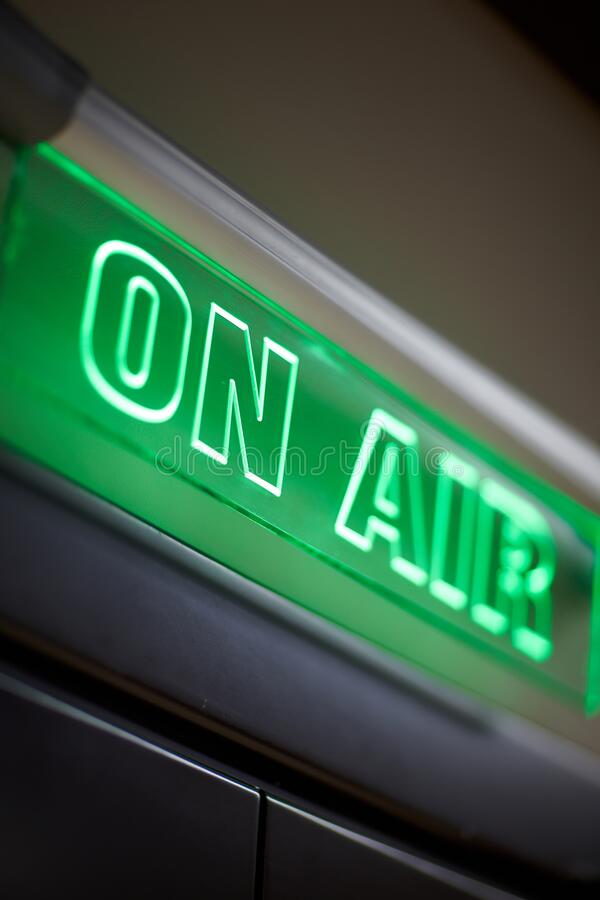 The inscription on air on a green scoreboard of the radio station royalty free stock photography
