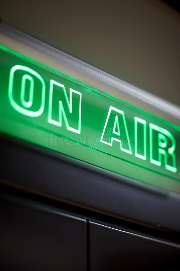 The inscription on air on a green scoreboard of the radio station royalty free stock photo