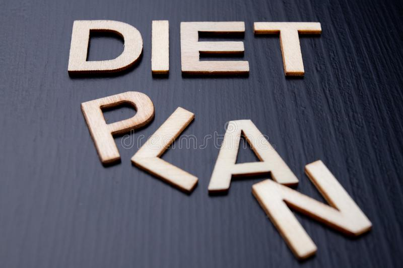 The inscription is arranged from letters cut out of wood on the table. The word diet plan stock image
