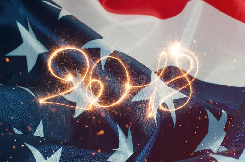 The inscription 2018 in the backdrop of the American flag,. Numbers sparklers stock images