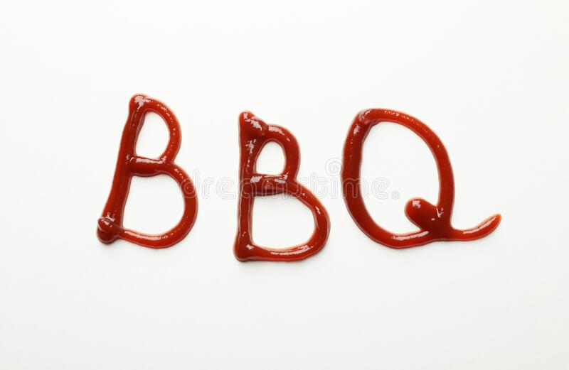 Inscription BBQ made of sauce on background, top view. Inscription BBQ made of sauce on white background, top view royalty free stock image