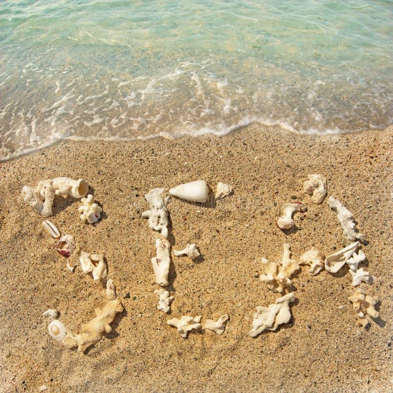 Inscription on the beach stock photo