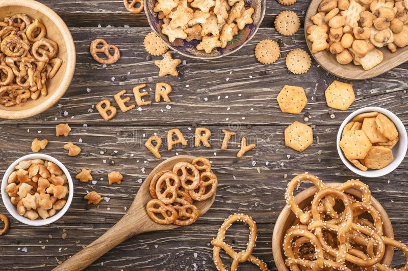 Inscription beer and party composed of crackers on a wooden boar royalty free stock photos